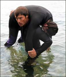 SCUBA instructor saving a person from drowning